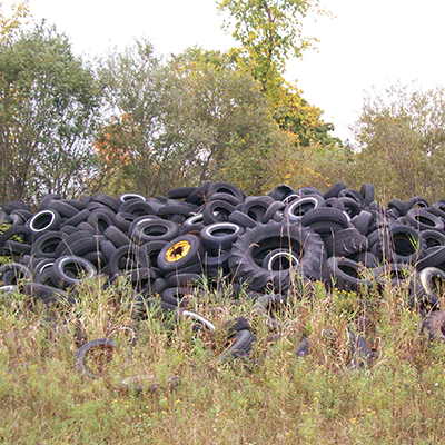 A pile of old tires in a field