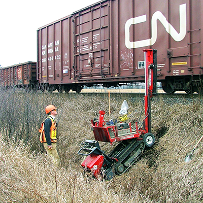 environmental worker runs tests along site a train